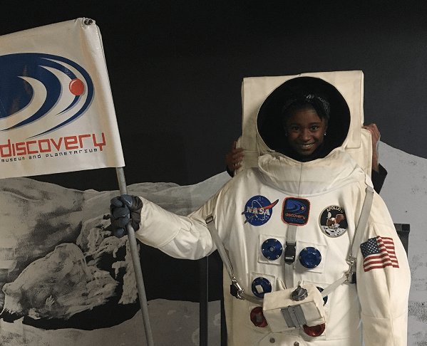Student dressed up as astronaut.