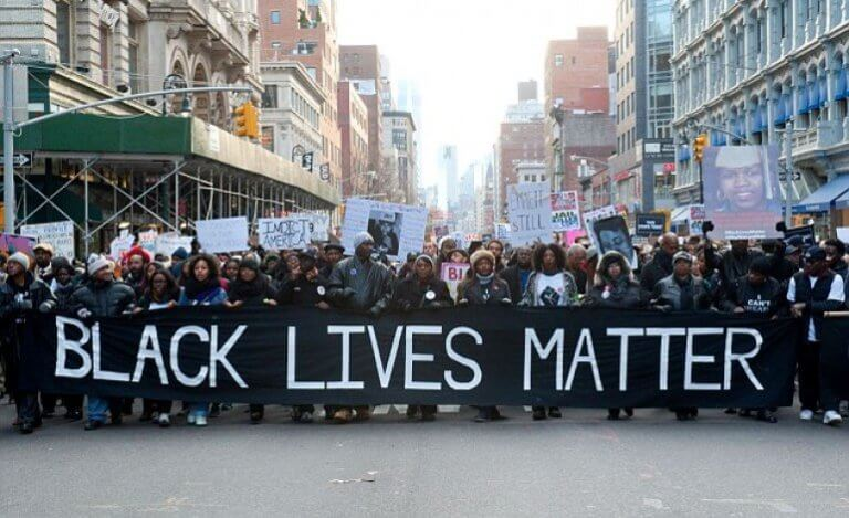 Protesters holding a Black Lives Matter banner