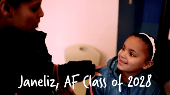 A student from AF smiles at her mom