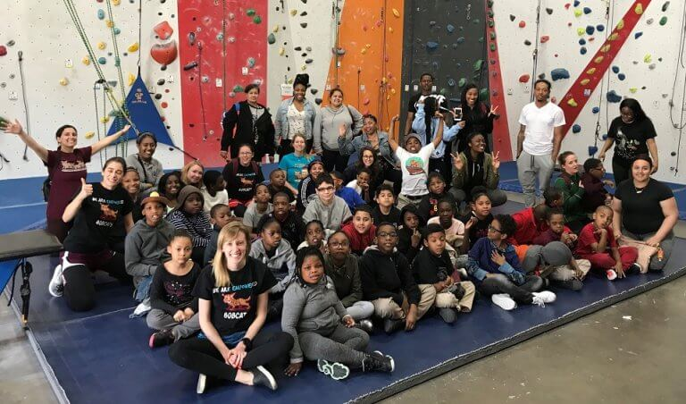 Students and teachers at a rock climbing field trip