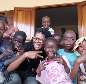 Ryana posing with children from Senegal