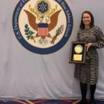 Courtney with the Blue Ribbon Schools plaque